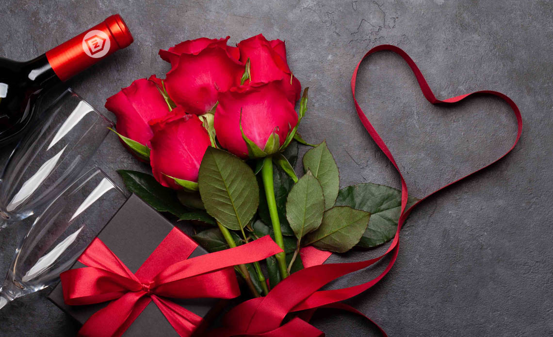 red roses and a wine bottle for a virtual wine tasting