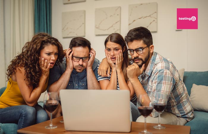 Friends looking at a virtual tasting with confused faces